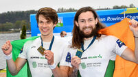 Fintan McCarthy and Paul O'Donovan celebrate with their 1st place medals 11/4/2021