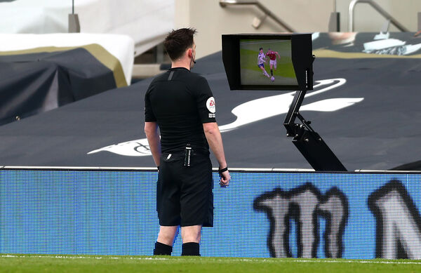 Referee Chris Kavanagh consults the pitchside VAR screen before ruling out Manchester United's Edinson Cavani's first goal against Tottenham Hotspur. Picture: James Warwick