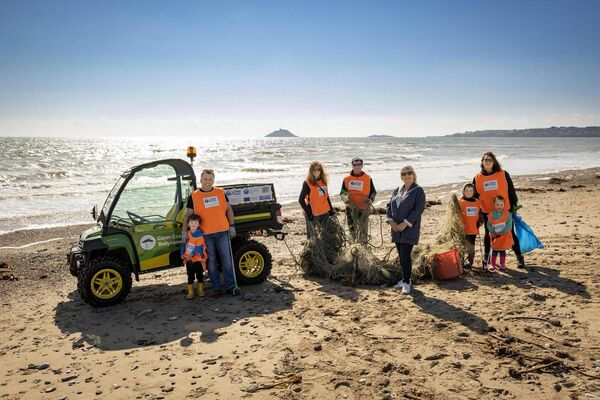 Pictured at the delivery of a new John Deere Gator this week at Ardnahinch beach, Co. Cork, were (left/right) Odhran Ó Tuama with his father Proinsias Ó Tuama, founder of Clean Coasts Ballynamona, local volunteers, Sally O'Reilly and Tomas Mulcahy, Mayor of the County of Cork, Cllr. Mary Linehan Foley, and Clare O' Dwyer with her two children Rory and Eda Fleming. Photo: Cathal Noonan