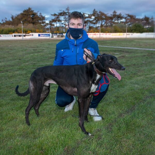 Seomra Nate, who took the fourth heat of the second round of the Greyhound & Petworld Supersprint at Curraheen Park on Saturday night. Pictured with trainer Chris Houlihan.