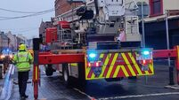 Emergency services dealing with potentially dangerous building on Cork city street