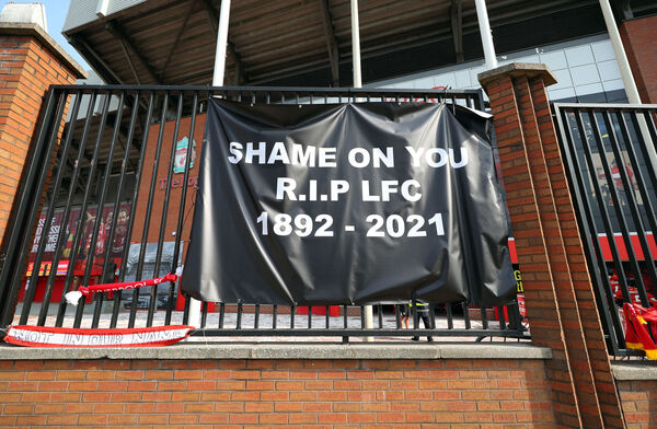 Banners outside of Anfield Stadium, Liverpool protesting against the club's decision to join the European Super League (ESL). Picture: Peter Byrne/PA Wire