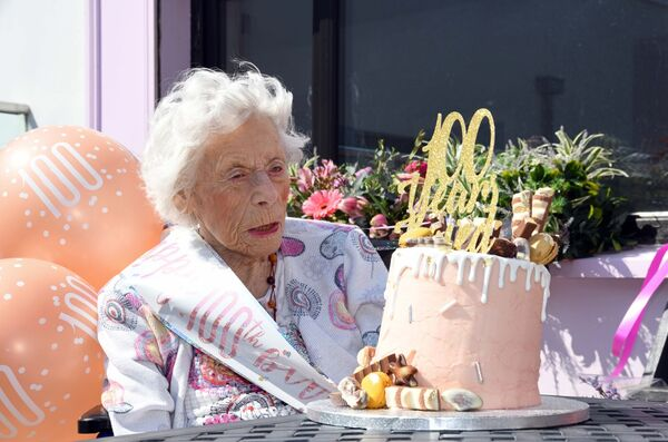 Armande Patricia Brabants Quillinan celebrating her 100th birthday with her birthday cake at the Haven Bay Care Centre, Kinsale, Co. Cork. Picture Denis Minihane.