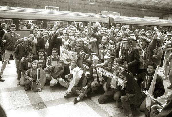 Derry City supporters arrive at Kent Station for the cup match against Cork City in 1986.