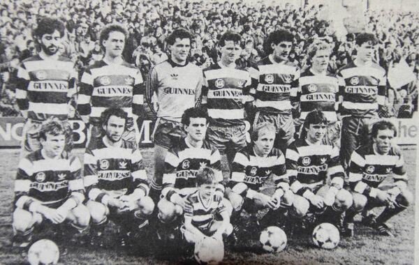 Cork City v Derry City, FAI Cup quarter-final, March 16, 1986. Back: Paddy Hughes, Liam Keane, Jim Mulcahy, Kevin Kearney, Stuart Ashton, Bob O'Donovan, Ian Hennessy. Front: Barry Neiland, Charlie McCarthy, Anto Whelan (c), Barry Hennebry (mascot), Pat 'Ginger' Healy, Mick O'Keeffe, Jimmy Nodwell.