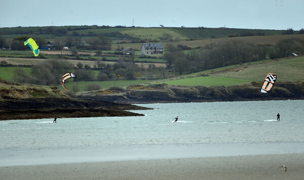 Paragilders in action at Courtmacsherry bay yesterday.