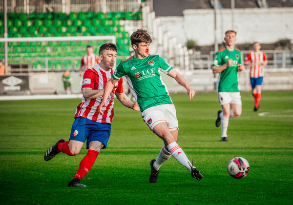 Treaty United's Ed McCarthy battles Cork City's Ronan Hurley in Friday's League of Ireland clash. Picture: Brian Arthur