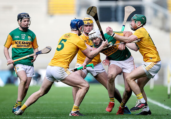 Antrim's Gerard Walsh, Joe Maskey and Niall McKenna with Jason Diggins of Kerry. Picture: INPHO/Tommy Dickson
