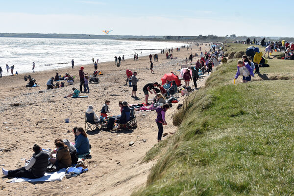 Crowds which braved the cold easterly wind at a sunny Youghal beach. Picture: Eddie O'Hare.