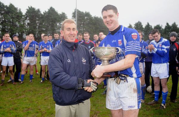 Des Cullinane presenting the Higher Education League trophy to the captain of the victorious Garda Training College team Michael Cussen. Picture Des Barry