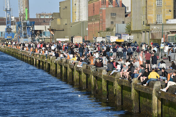 People gathered over the weekend on Kennedy Quay, Cork to enjoy the evening sunshine and takeaway refreshments. Picture Dan Linehan