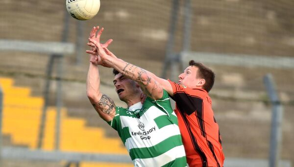 Valley Rovers' Fiachra Lynch battles Duhallow's John Mcloughlin. Picture: Eddie O'Hare