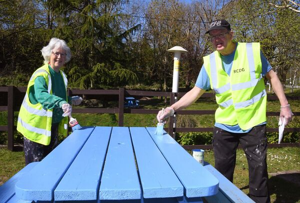 Helen and John Fox of Rochestown Community Development Group helping with the painting of picnic tables at Rochestown village green in Cork. Picture Denis Minihane.