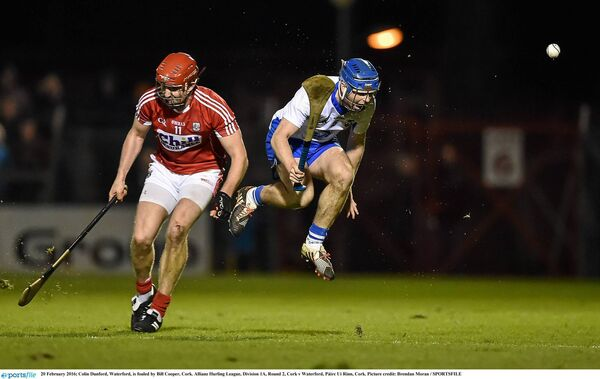 Colin Dunford, Waterford, is fouled by Bill Cooper, Cork, in the 2016 Allianz Hurling League at Páirc Uí Rinn. Picture: Brendan Moran/SPORTSFILE
