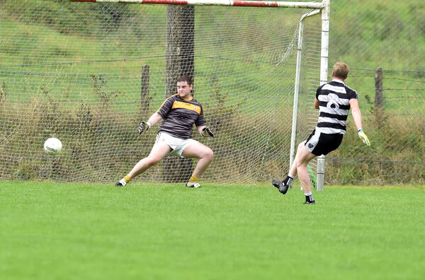 Castletownbere's Andrew O'Sullivan beats Na Piarsaigh goalkeeper Alan O'Sullivan. Picture: Eddie O'Hare