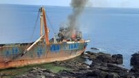 Garda probe into 'Ghost ship' fire, Council warn public to 'stay away'